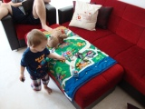Get a glimpse of our couch set with Davy playing on his road blanket on top of our Poof!